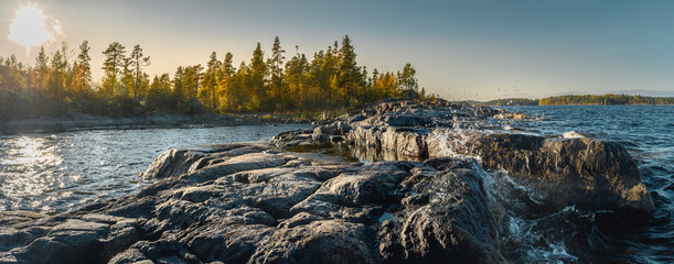 Fotorolgordijn Bleke violet Beautiful panorama of a rocky shore. Nordic sunrise or sunset. Scenic view