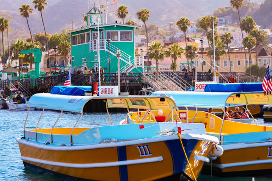 Colorful water taxi boats sit moored near the famous Green Pier at Avalon, on Catalina Island
