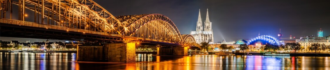 Panorama of the city of Cologne at night with Cologne Cathedral, Hohenzollern Bridge and Rhine river