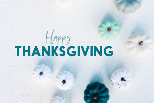 Happy Thanksgiving holiday banner with flat lay of trendy pumpkins on white background.