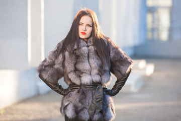 Woman in fur coat, black leather gloves