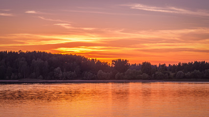 Acrylic Prints Coral sunset on the forest lake golden hour