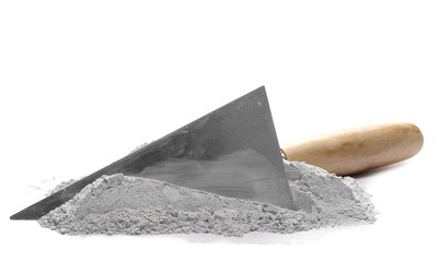 Cement pile and trowel isolated on white background