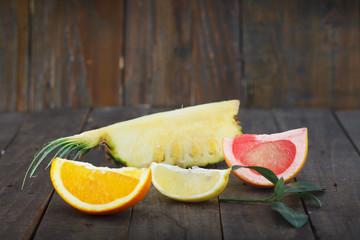 Slices of pineapple, orange, grapefruit and lemon. Citrus fruit for healthy life.