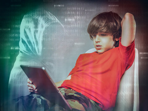 young child with tablet  internet  addiction and  dangers concept