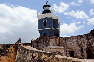 View of the lighthouse, which was built in 1908 A.D. on top of the 16th century El Morro fortress in Old San Juan, Puerta Rico