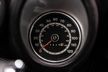 Old classic car speedometer and odometer. Vintage car