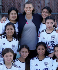 U.S. Women's National Team soccer star Alex Morgan poses for a picture with a girls high school soccer team as she unveils a mini-pitch, part of the U.S. Soccer Foundation's Safe Places to Play program, in Gardena, California
