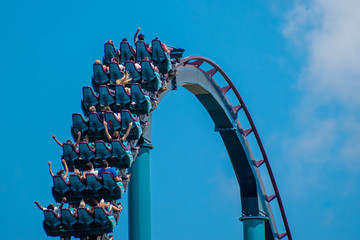 People enjoying riding rollercoaster during summer vacation 48