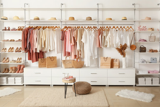 Interior of show room with stylish clothes and accessories