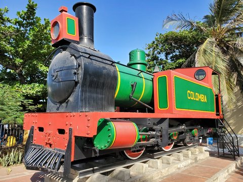 Hudswell, Clarke - British built train locomotive in the city of Barranquilla, Colombia. Green and Red Paint, Colombia written on train with Yellow Letter