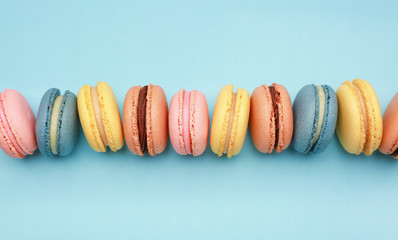 Acrylic Prints Macarons Different tasty macarons on color background
