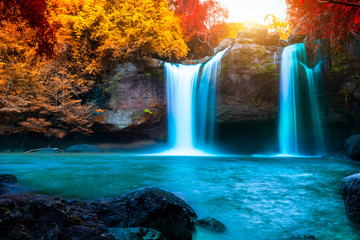 Door stickers Waterfalls The amazing colorful waterfall in autumn forest blue water and colorful rain forest.