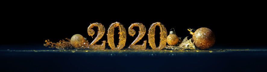 2020 in sparkling gold numbers celebrating the New Year or Christmas with glittering ornaments and...
