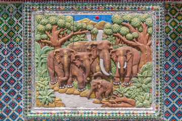 Tiled picture of elephants on a wall in a temple in Bangkok, Thailand