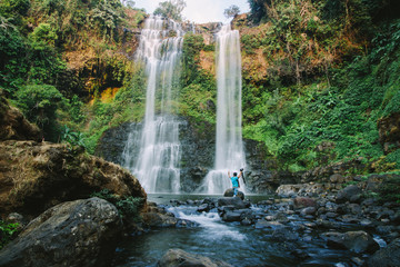 Spoed Fotobehang Bos rivier Travel to the most beautiful waterfalls, hard to find