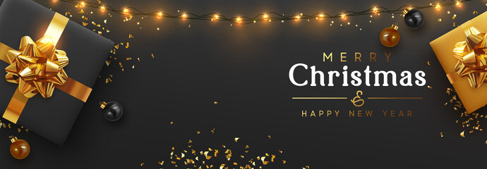 Christmas banner. Background Xmas design of sparkling lights garland, realistic gifts box, black balls and glitter gold confetti. Horizontal christmas poster, greeting cards, headers website Wall mural
