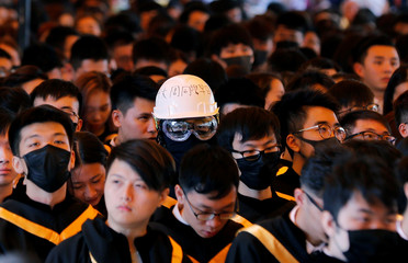 A graduate wearing a helmet during a graduation ceremony at the Chinese University of Hong Kong in Hong Kong