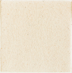 background and texture of stretch marks cracked on white cream glazed tile