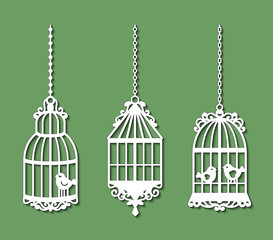 Foto op Aluminium Vogels in kooien Set of laser cut template of birdcages. Openwork silhouette of cages for birds with lace ornament. Decoration for paper cutout. Design for laser or die cutting. Vector illustration on green background