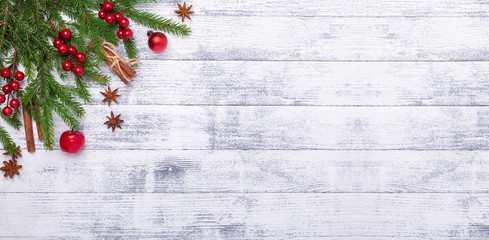 Christmas background with fir tree and red gifts on wooden table. Horizontal banner. Top view Copy space - Image