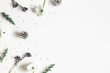 Christmas composition. Frame made of winter plants on white background. Christmas, winter concept. Flat lay, top view, copy space