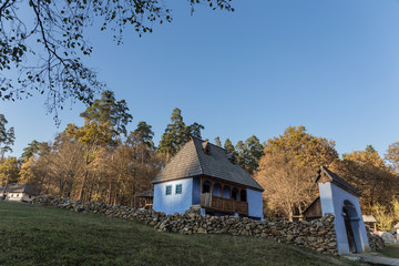 Traditional blue Romanian house on a beautiful autumn afternoon