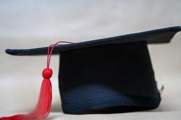 close up Black graduation cap And red tassels