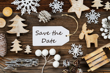 One White Label With English Text Save The Date. Frame Of Christmas Decoration Like Tree, Sled, Star And Fir Cone. Wooden Background