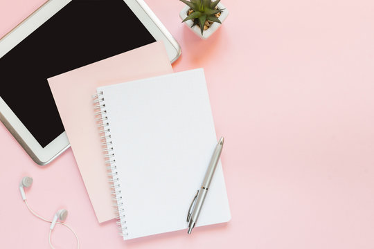 Blank notebook for writing on spirals on a pink background, flat lay, the end of motivation, business, building goals with negative industrial space and copy space