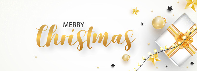 Merry Christmas celebration header or banner design with top view of gift box, baubles, stars and lighting garland decorated on white background.