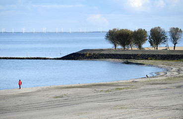 A general view shows reinforcement of Houtribdijk made of sand from lakes surrounding the dike in Lelystad