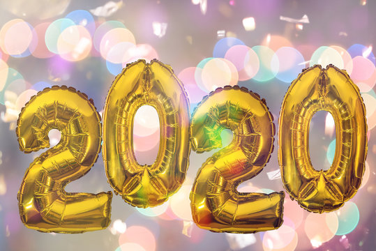 2020 number of gold foil balloons on blurred abstract background