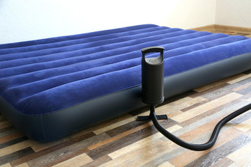 Air bed inflatable mattress and foot pumper good for sleep. Portable and cheap bed.