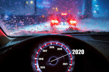 Going to the New Year 2020 by the car at snowy night
