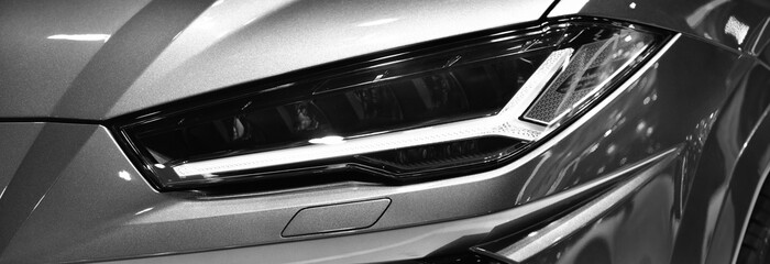Wall Mural - Close up Detail on one of the LED headlights modern car. black and white