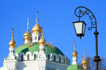 Lantern on the background of the Kiev Pechersk Lavra