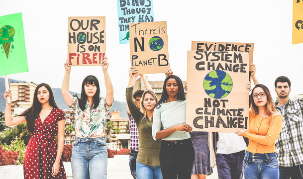 Group of demonstrators on road, young people from different culture and race fight for climate change - Global warming and enviroment concept - Focus on center guys faces