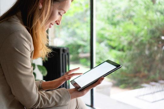 Females hands holding digital tablet