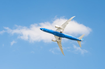 A display of aerobatic agility by a Boeing 787 Dreamliner during an exhibition flight over Farnborough, UK - July 14, 2014