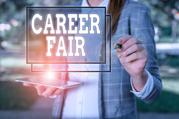 Handwriting text Career Fair. Conceptual photo an event at which job seekers can meet possible employers Outdoor background with business woman holding lap top and pen