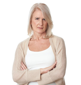 Angry senior blonde woman. Isolated on white