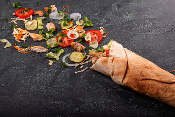 Ingrdients for popular arabic turkish fastfood doner shawarma roll with meat and vegetables. Top view
