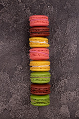 Spoed Foto op Canvas Macarons Stack of colorful macarons over on black background. Copy space, top view