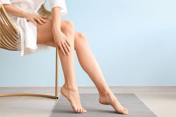 Woman with beautiful legs after depilation at home Fotomurales