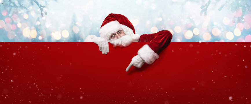 Santa Claus Showing Something On a Red Wall