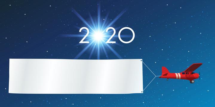 Carte de vœux 2020 sur fond de ciel étoilé, avec un avion rouge tirant une banderole blanche pour écrire un message ou souhaiter ses meilleurs vœux pour la nouvelle année.