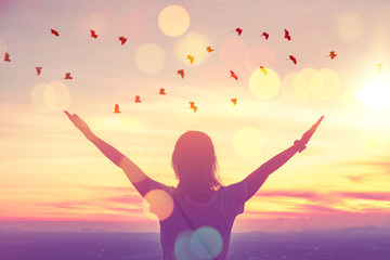 Keuken foto achterwand Ochtendgloren Freedom feel good and travel adventure concept. Copy space of silhouette woman rising hands on sunset sky at top of mountain and bird fly abstract background.