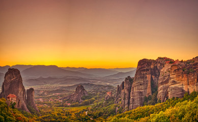 Garden Poster Orange Landscape with monasteries and rock formations in Meteora, Greece. during sunset.