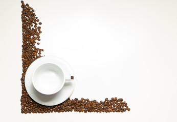 White cup with plate in coffee beans on the white background. Food or drink background photo with place for text.